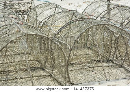 Crab traps stacked near bay in Thailand