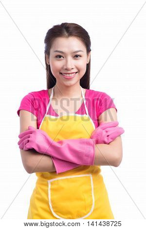 Smiling young cleaning asian lady with pink rubber gloves up over white