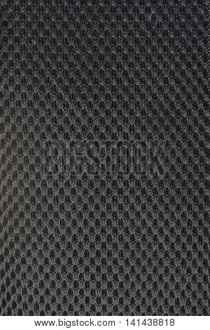 black gray fishnet cloth material as a texture background