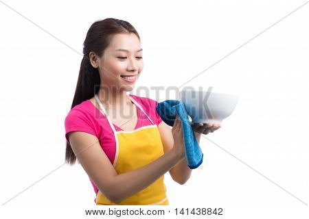 Young asian woman washed the dishes on white