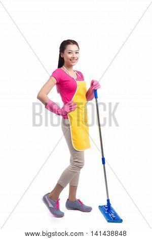 Portrait Of Young Asian housewife Cleaning Floor With Mop in full length