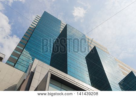 Perspective and underside angle view to textured background of modern glass buildingCommon modern business skyscrapers high-rise buildings Concepts of financial economics