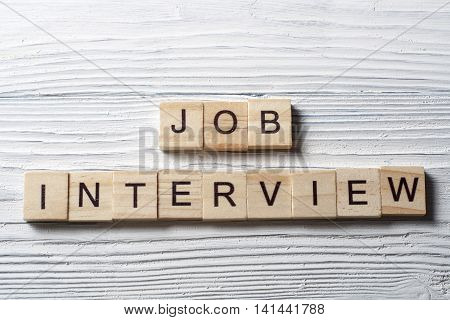 Job Interview word written on wood block. Wooden Abc