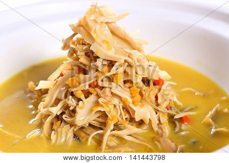 Bamboo shoots soup on white bowl in restaurant