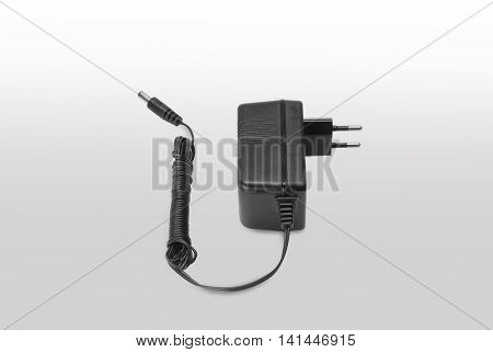 Isolated black adapter on white and gray background