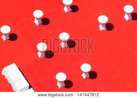 White banquet tables on red outdoor view from above