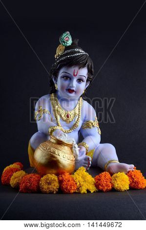 Hindu God Krishna. Statue of God Krishna on dark background