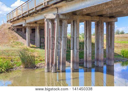 river muddy water flowing under the bridge
