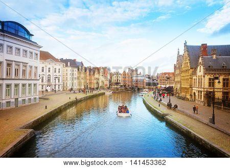 Scene of Graslei harbor at day, Ghent, Belgium, retro toned