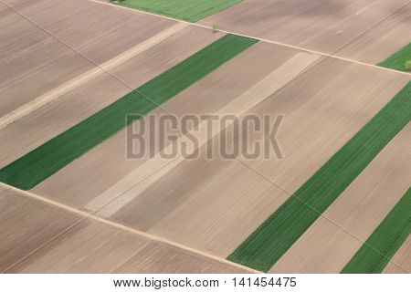 Fields from the air. Fields aerial photo. Aerial photography of green fields. Green fields aerial view.