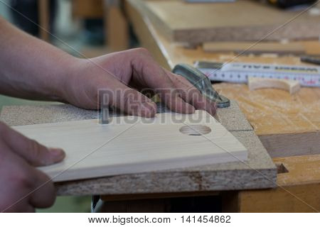 Carpenter working with a saw on a piece of wood