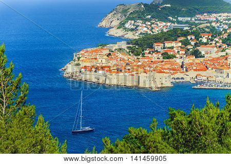 Old Town of Dubrovnik and luxurious yacht Croatia Europe. City on Adriatic Sea Dalmatia one of most prominent tourist Mediterranean Sea destinations seaport and centre of Dubrovnik-Neretva County