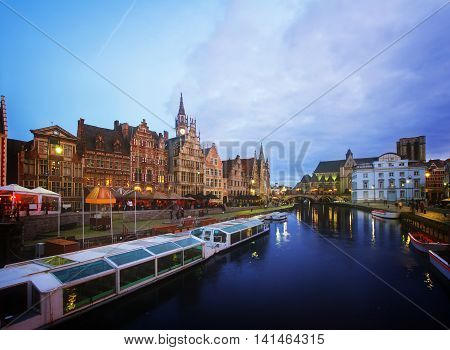View of old harbour with tourboats moored, Ghent, Belgium, toned