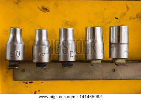 Hex Socket set in the auto tools box. A workplace of the mechanic