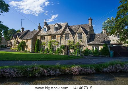 LOWER SLAUGHTER, GLOUCESTERSHIRE  UK - JUNE 24, 2016. Typical Cotswold stone cottages in the small village of Lower Slaughter which is a popular tourist destination in the heart of The Cotswolds, UK.