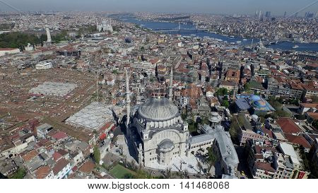Aerial view of the Istanbul city. There are mosques, buildings and city life.