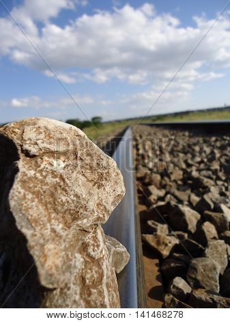 Rocks placed on a railway track photo taken from a close angle.