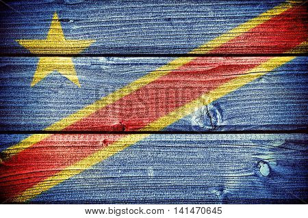 3d illustration flag of the Democratic Republic of the Congo painted on old grungy wooden background