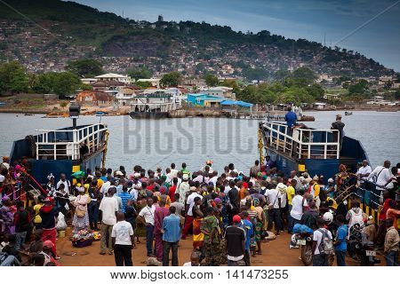 Freetown Sierra Leone - June 1 2013: arrival of the ferry at the harbor of Freetown
