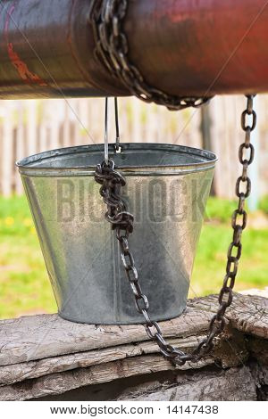 Empty Pail, Chain And Well Pulley