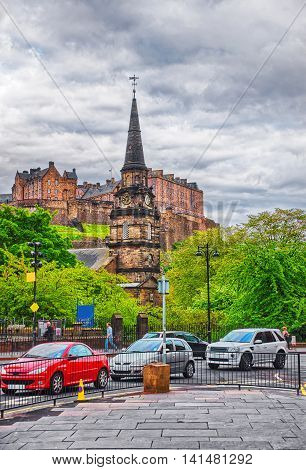 Edinburgh, UK - May 11, 2011: Parish Church of St Cuthbert and Edinburgh Castle on the rock view from the street in Edinburgh in Scotland. It is the capital of Scotland in the United Kingdom.