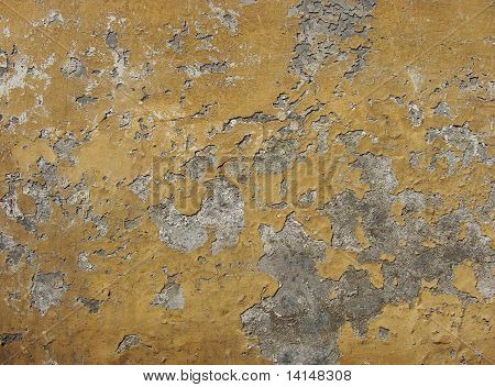 Oker Colored Worn Wall With Blathering Paint
