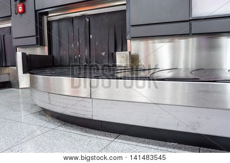 at the international airport upon arrival there are several conveyor suitcases