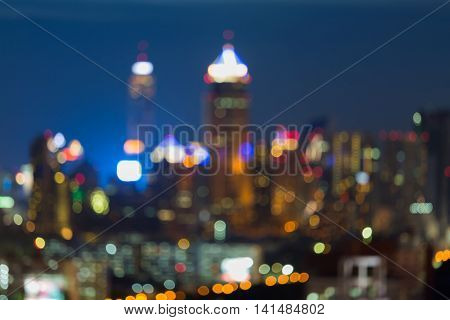 Blurred bokeh city lights at twilight, abstract background