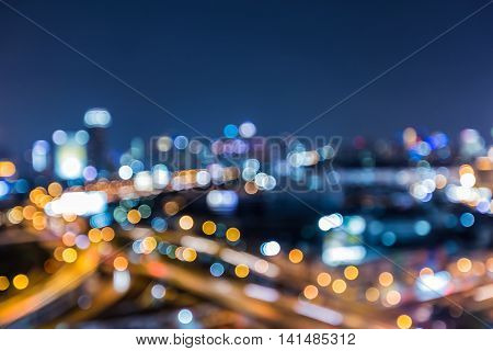 Abstract blurred lights bokeh city highway interchanged at twilight