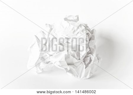 Photo of crumpled paper ball on white background