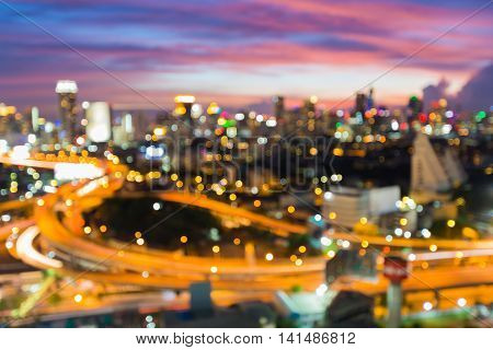 Abstract blurred bokeh lights city and highway with beautiful sky background
