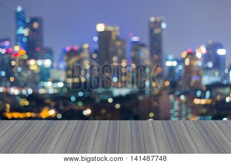 Opening wooden floor, Abstract bokeh light background, city downtown background