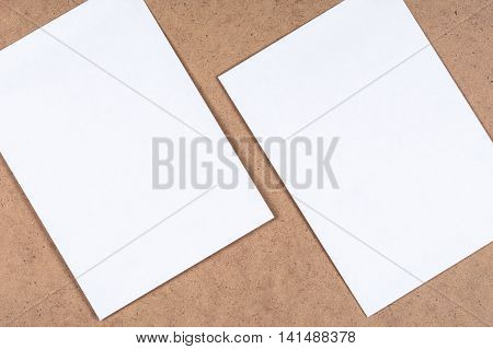 White blank paper sheets on the fibrous cardboard