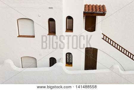 White facade of a traditional spanish mediterranean arquitecture building in Roc of Sant Gaieta village in Roda de Bera Tarragona Catalonia Spain.