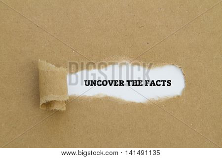 Uncover the facts written on a brown torn paper