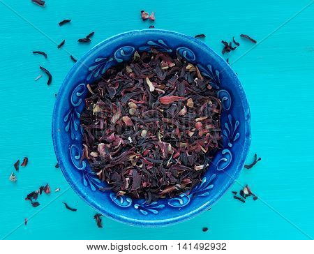 dried hibiscus flowers on a turquoise background