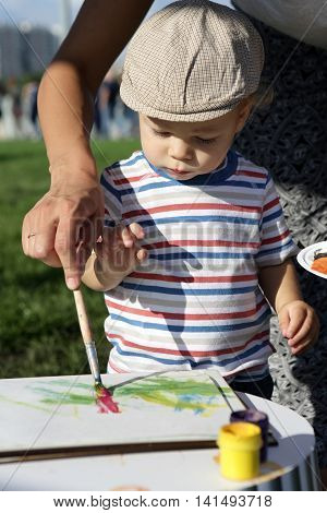 Mother Helping Son To Paint
