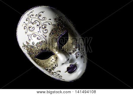 Venetian souvenir mask on black background isolated.