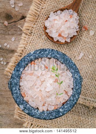 Himalayan Pinhimalayan Pink Salt In Mortar With Thyme On Hemp Sack Background. Himalayan Salt Common