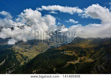 Snow capped alpine mountains. Trek near Matterhorn mount.