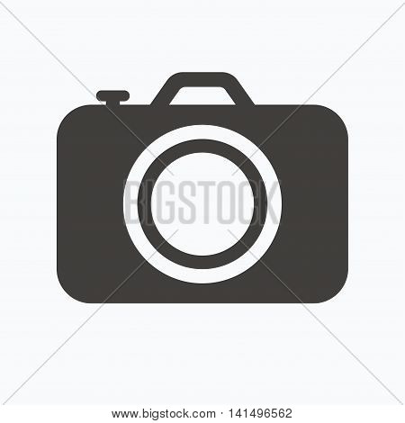 Camera icon. Professional photocamera symbol. Gray flat web icon on white background. Vector