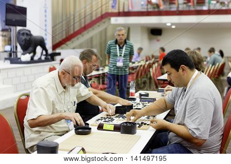 ST. PETERSBURG, RUSSIA - AUGUST 5, 2016: Participants of European Go Congress play in the playing hall. 1176 people from 48 countries are registered in this 60th Congress