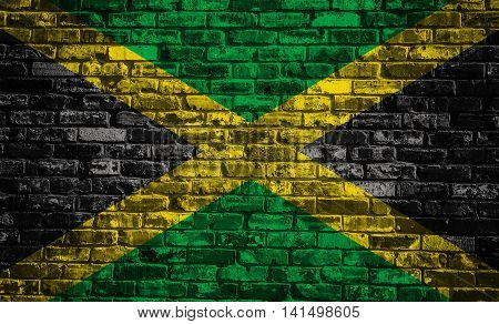 Flag of Jamaica on old brick wall background