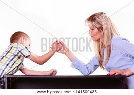 Mother And Son Arm Wrestle Sit At Table.