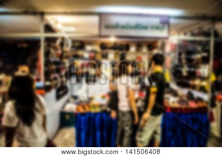 The trade fair booth selling cheap goods from the manufacturer. A game show and giveaways. Abstract blur
