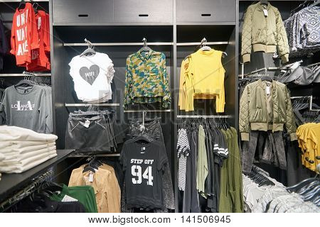 SHENZHEN, CHINA - FEBRUARY 05, 2016: H and M store at KK Mall in Shenzhen. H and M known for its fast-fashion clothing for men, women, teenagers and children.