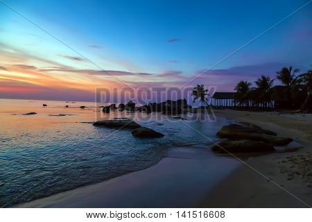 Palm Trees silhouettes Colorful Sky Sunset or Sunrise Tropical landscape sea, outdoor activity on tropical summer vacations