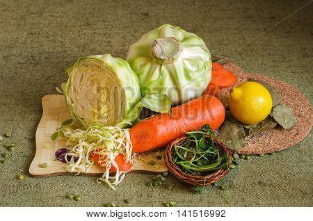 Set oSet of fresh vegetables for salad, kale, carrots with lemon and spicesf fresh vegetables for salad, kale, carrots