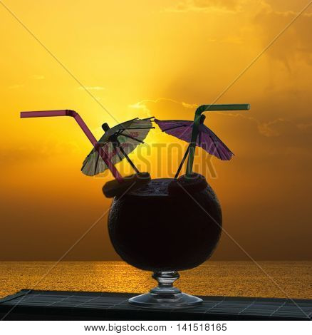 Cocktail on a tropical beach at sunset - outdoor activity on tropical summer vacations