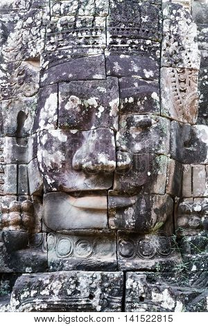 Stone Face Statue In Ancient Bayon Temple